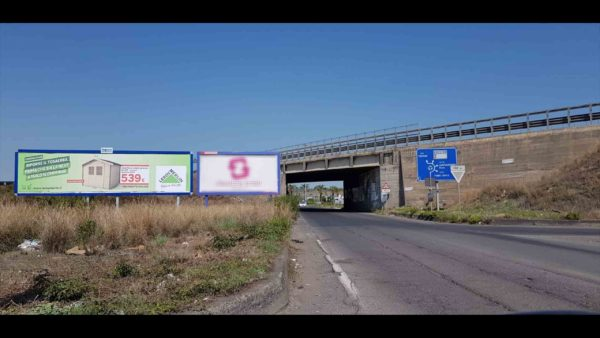 Uscita Valcorrente direzione Centro Commerciale Etnapolis Cartellone pubblicitario 12x3 mt Belpasso